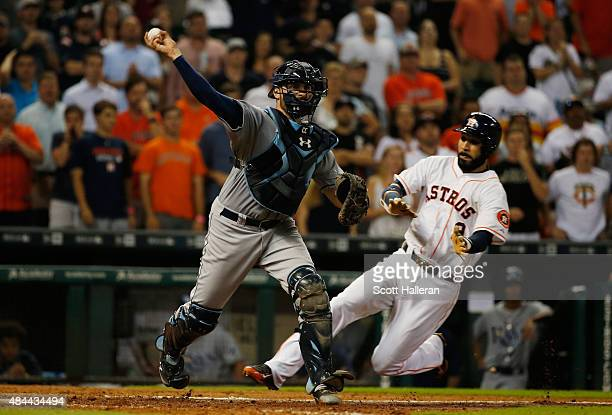 Curt Casali of the Tampa Bay Rays forces Marwin Gonzalez of the Houston Astros out at home plate in the eighth inning during their game at Minute...
