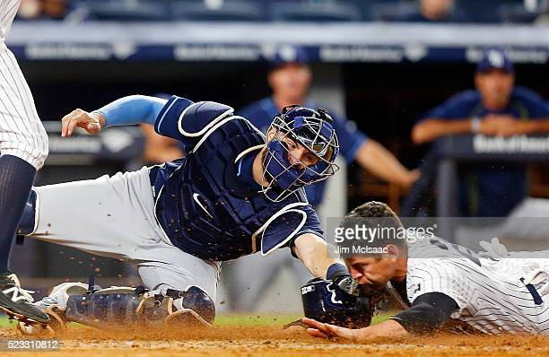Curt Casali of the Tampa Bay Rays is late with the tag as Jacoby Ellsbury of the New York Yankees steals home during the fifth inning at Yankee...