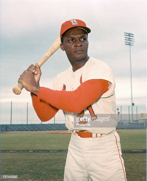 Curt Flood of the St. Louis Cardinals poses at bat. Curt Flood played for the Cardinals from 1958-1969.