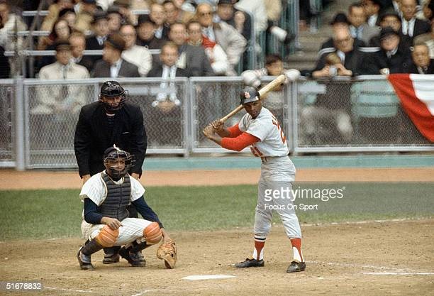 Curt Flood of the St Louis Cardinals stands ready at the plate during the1964 world series against the New York Yankees at Yankee Stadium in Bronx...