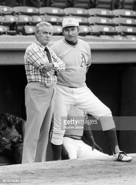 Curt Gowdy left speaks with Oakland Athletics baseball manager Alvin Dark right during a game against the Boston Red Sox at Fenway Park in Boston...