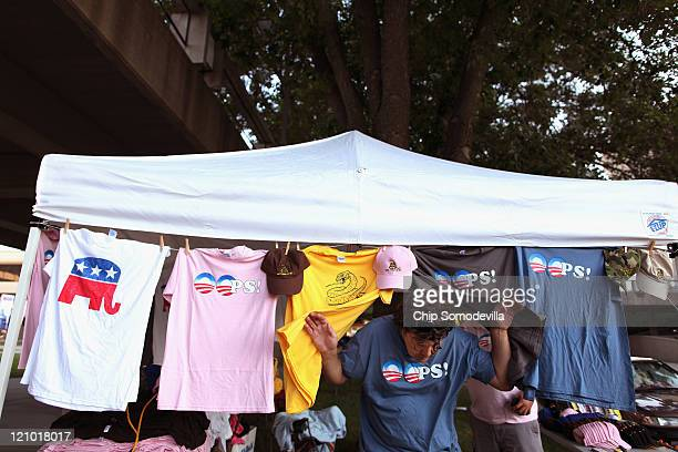 Curt Jacobson of Sarasota Florida sets up his tshirt and political button tent outside the Hilton Coliseum where Iowans will vote in the Iowa Straw...