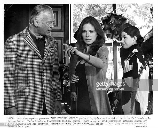 Curt Jurgens looking towards a pointing Jacqueline Bisset with a grinning Barbara Parkins in the background in a scene from the film 'The Mephisto...