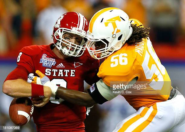 Curt Maggitt of the Tennessee Volunteers strips the ball from Mike Glennon of the North Carolina State Wolfpack at Georgia Dome on August 31, 2012 in...
