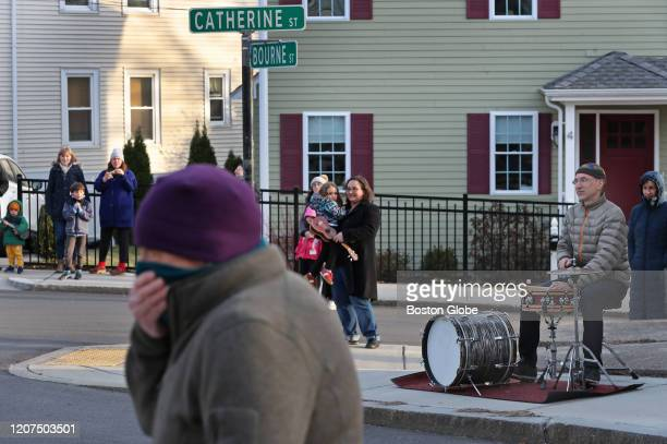 Curt Newton plays the drums as he and some of his neighbors get together and have a group singalong safely distanced from each other in their Boston...