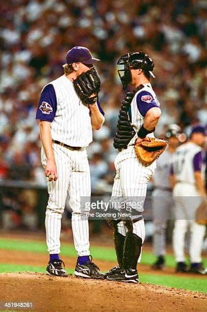 Curt Schilling and Damian Miller of the Arizona Diamondbacks during Game One of the World Series against the New York Yankees on October 27 2001 at...