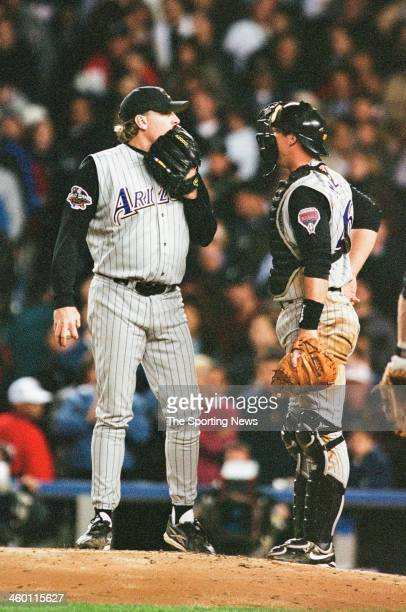 Curt Schilling and Damian Miller of the Arizona Diamondbacks talk during Game Four of the World Series against the New York Yankees on October 31...