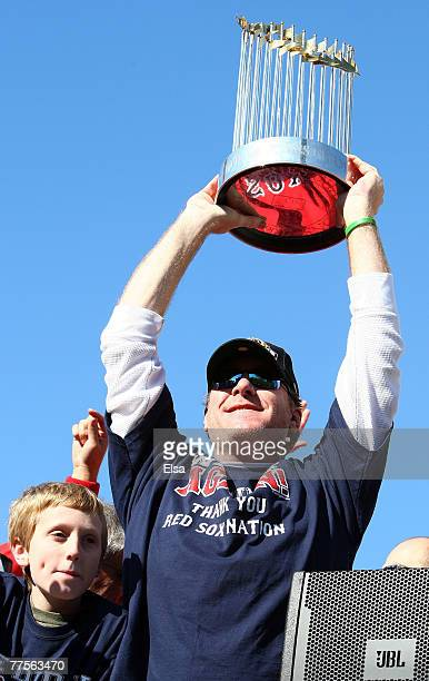 Curt Schilling holds up the World Series Trophy during the Boston Red Sox World Series victory celebration on October 30 2007 in Boston Massachusetts