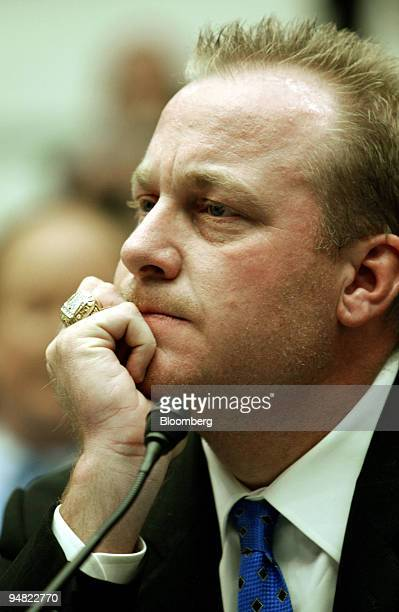 Curt Schilling of the Boston Red Sox listens during a hearing by the House Government Reform Committee on the use of steroids in baseball Thursday...