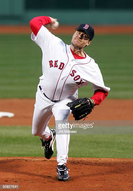 Curt Schilling of the Boston Red Sox pitches against the New York Yankees during the first inning of their game on April 13 2005 at Fenway Park in...