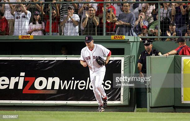 Curt Schilling of the Boston Red Sox runs out of the bullpen to pitch in relief against the New York Yankees in the ninth inning at Fenway Park on...