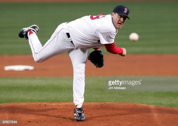 Curt Schilling of the Boston Red Sox strikes out lead off batter Tony Womack of the New York Yankees during the first inning of their game on April...