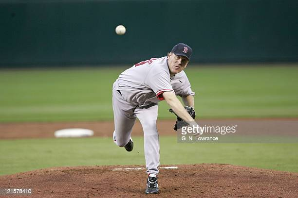 Curt Schilling of the Boston Red Sox throws a pitch against the Kansas City Royals at Kauffman Stadium in Kansas City Mo on August 25 2005 The Royals...