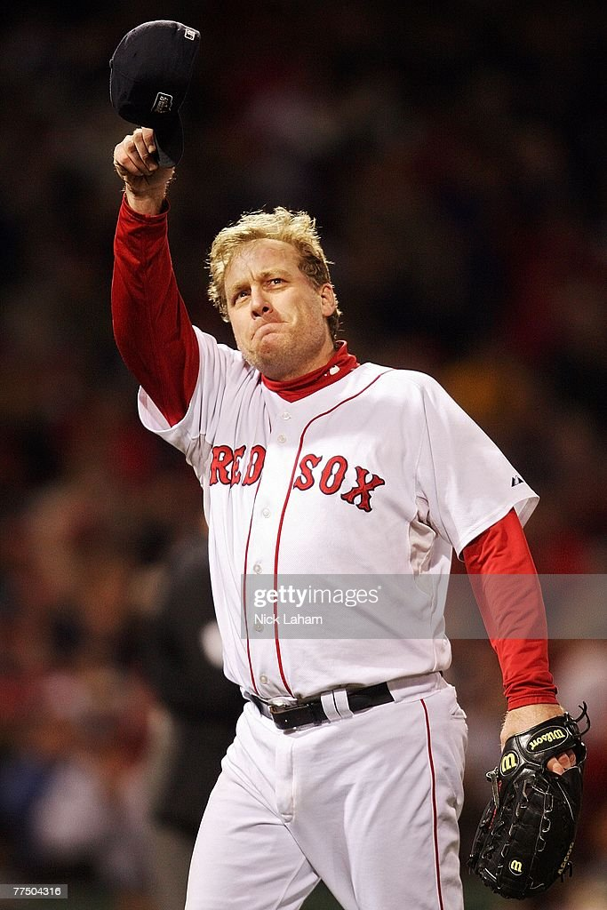 Curt Schilling #38 of the Boston Red Sox tips his hat to the crowd as he comes out of the game in the sixth inning against the Colorado Rockies during Game Two of the 2007 Major League Baseball World Series at Fenway Park on October 25, 2007 in Boston, Massachusetts.