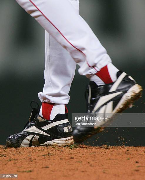 Curt Schilling of the Boston Red Sox winds up to throw a pitch in the first inning against the St. Louis Cardinals during game two of the World...