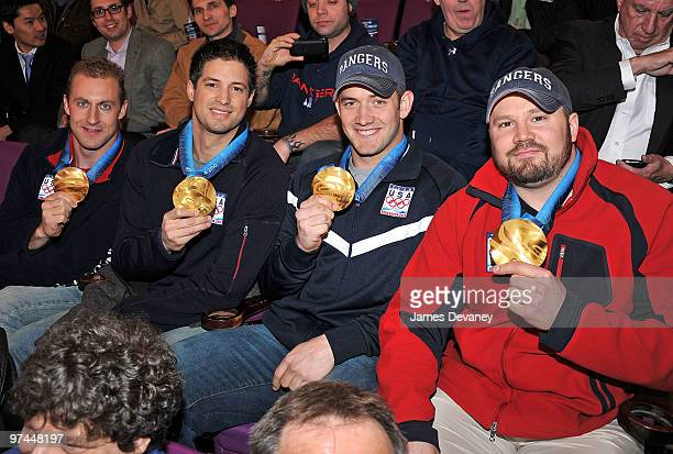 Curt Tomasevicz Steve Mesler Justin Olsen and Steve Holcomb of the USA Olympic Bobsled team attends the Pittsburgh Penguins Vs New York Rangers game...