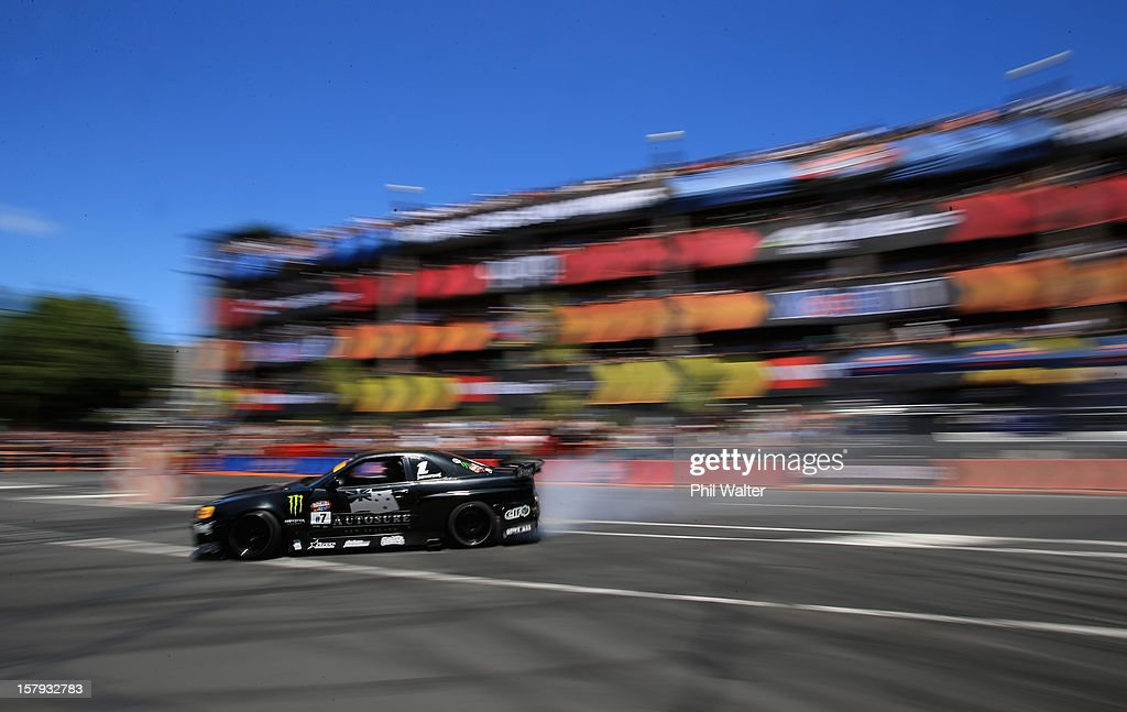 Curt Whittaker of New Zealand competes in the Red Bull Drift Shifters along Victoria Street on December 8, 2012 in Auckland, New Zealand.