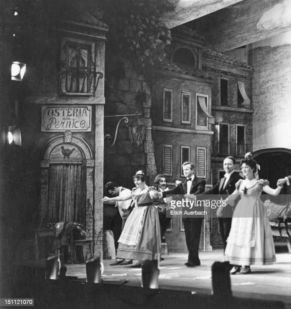 Curtain call at the end of a performance of Donizetti's opera 'L'Elisir d'Amore' at Glyndebourne, East Sussex, 24th May 1961. Pictured are producer...