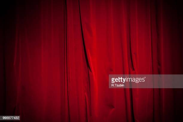 curtain from the theater with a spotlight as background - cabaret stock pictures, royalty-free photos & images