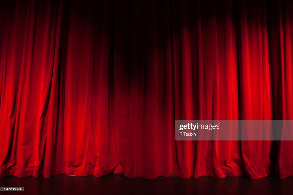 Curtain from the theatre with a spotlight as background : Stock Photo