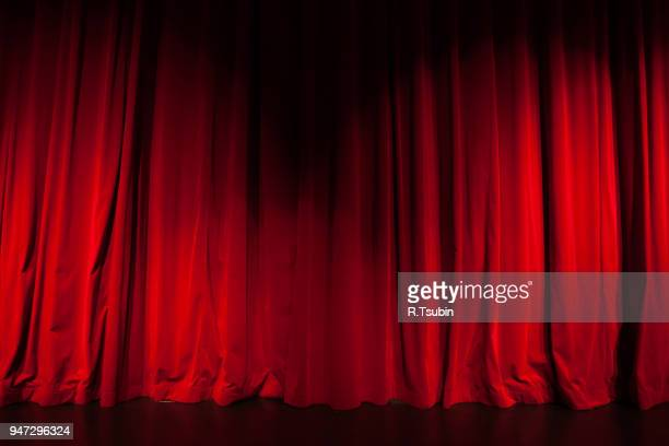 curtain from the theatre with a spotlight as background - film  oder fernsehvorführung stock-fotos und bilder