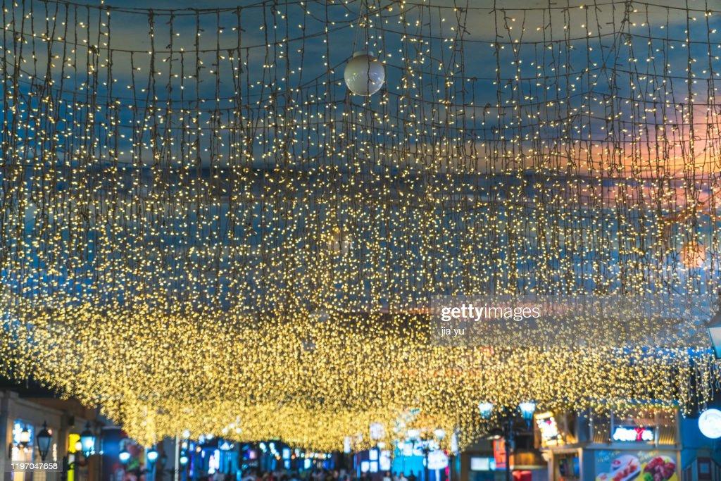A curtain of small light bulbs. : Stock Photo