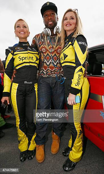 Curtis '50 Cent' Jackson poses with Miss Sprints Kim Coon and Brooke Werner during the NASCAR Sprint Cup Series Daytona 500 at Daytona International...