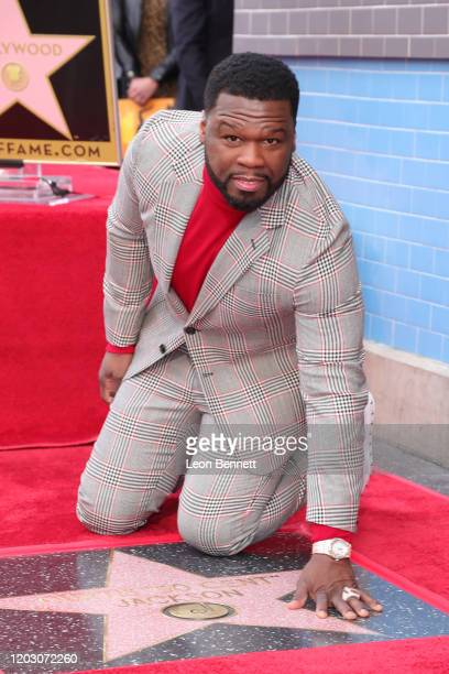 Curtis 50 Cent Jackson poses with star during his ceremony on the Hollywood Walk of Fame on January 30 2020 in Hollywood California