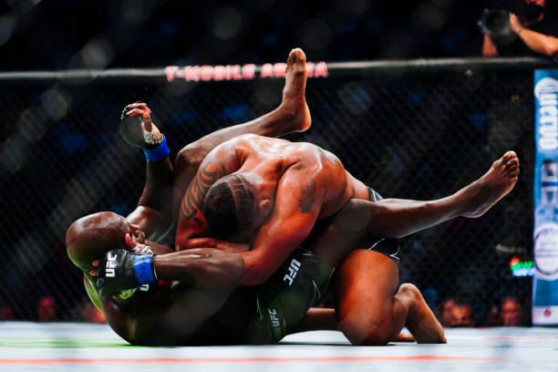 Curtis Blaydes and Jairzinho Rozenstruik grapple during their Heavyweight fight during UFC 266 at T-Mobile Arena on September 25, 2021 in Las Vegas,...