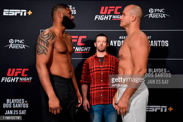 Curtis Blaydes and Junior Dos Santos of Brazil face off during the UFC Fight Night weighins at the Embassy Suites Raleigh Crabtree on January 24 2020...