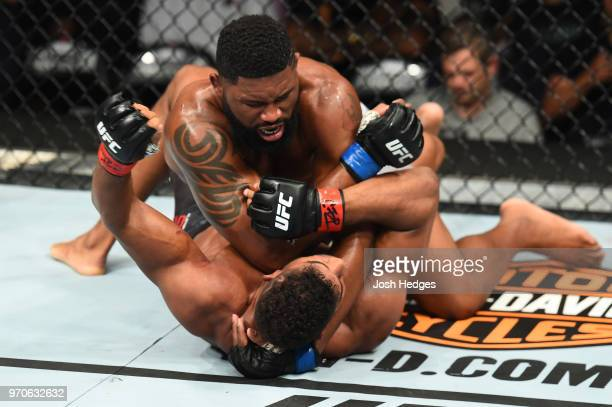 Curtis Blaydes elbows Alistair Overeem in their heavyweight fight during the UFC 225 event at the United Center on June 9 2018 in Chicago Illinois