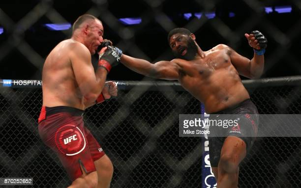 Curtis Blaydes lands a punch against Aleksei Oleinik of Russia in their heavyweight bout during the UFC 217 event at Madison Square Garden on...