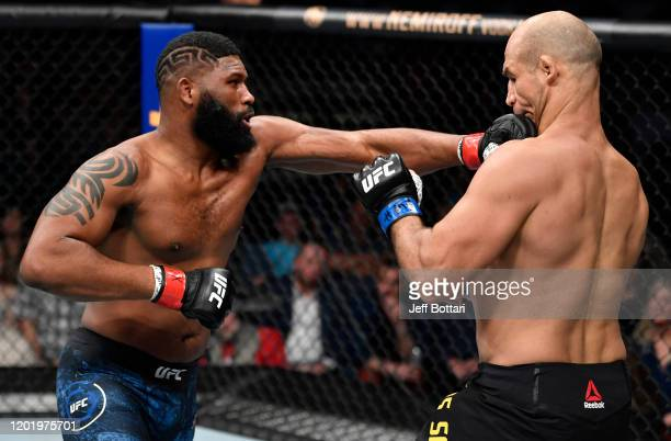 Curtis Blaydes punches Junior Dos Santos of Brazil in their heavyweight fight during the UFC Fight Night event at PNC Arena on January 25 2020 in...