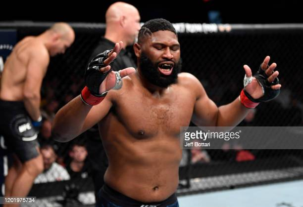 Curtis Blaydes reacts after landing an accidental low blow against Junior Dos Santos of Brazil in their heavyweight fight during the UFC Fight Night...