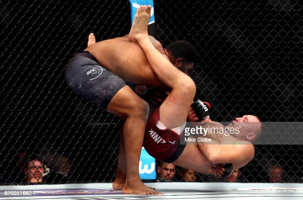 Curtis Blaydes slams Aleksei Oleinik of Russia in their heavyweight bout during the UFC 217 event at Madison Square Garden on November 4 2017 in New...