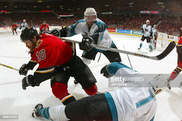 Curtis Brown of the San Jose Sharks hits Dave Lowry of the Calgary Flames during Game four of the 2004 NHL Western Conference Finals on May 16 2004...