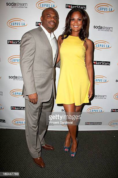 Curtis Conway and Laila Ali attend Get Lucky For Lupus LA at Peterson Automotive Museum on September 12 2013 in Los Angeles California