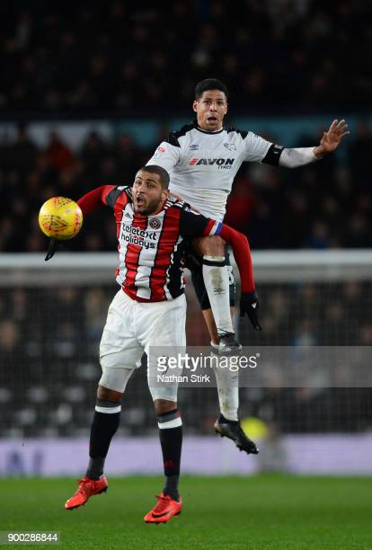 Curtis Davies of Derby County and Leon Clarke of Sheffield United compete for the ball during the Sky Bet Championship match between Derby County and...