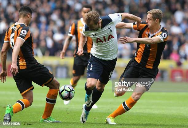 Curtis Davies of Hull City and Michael Dawson of Hull City attempt to stop Harry Kane of Tottenham Hotspur during the Premier League match between...