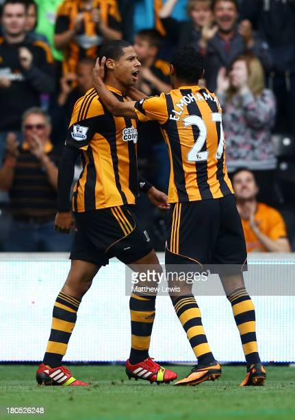 Curtis Davies of Hull City celebrates with Ahmed Elmohamady as he scores their first goal during the Barclays Premier League match between Hull City...