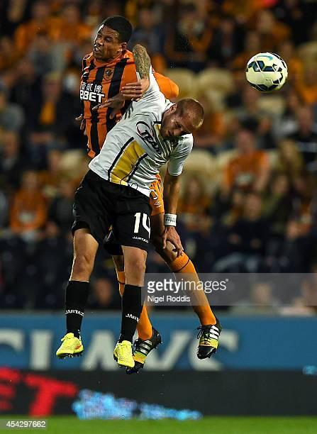 Curtis Davies of Hull City chllenges Jordan Remacle of KSC Lokeren during the Hull City v KSC Lokeren UEFA Europa League Qualifying PlayOffs Round...