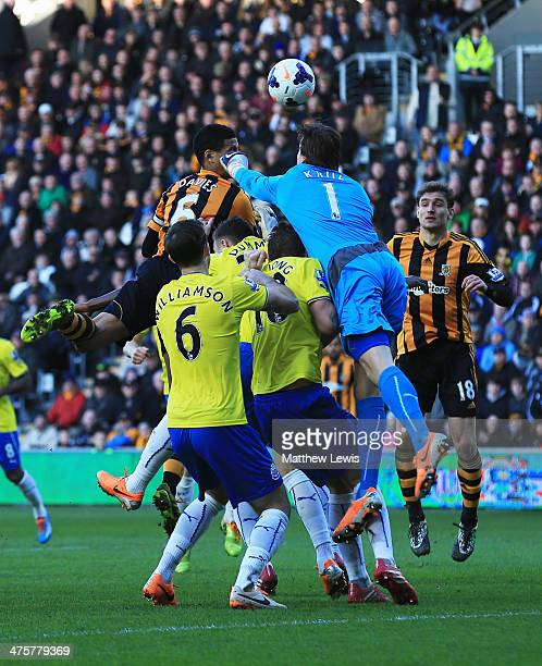 Curtis Davies of Hull City outjumps goalkeeper Tim Krul of Newcastle United to score their first goal during the Barclays Premier League match...