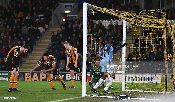 Curtis Davies of Hull City reacts after scoring an own goal for Manchester City's third goal during the Premier League match between Hull City and...