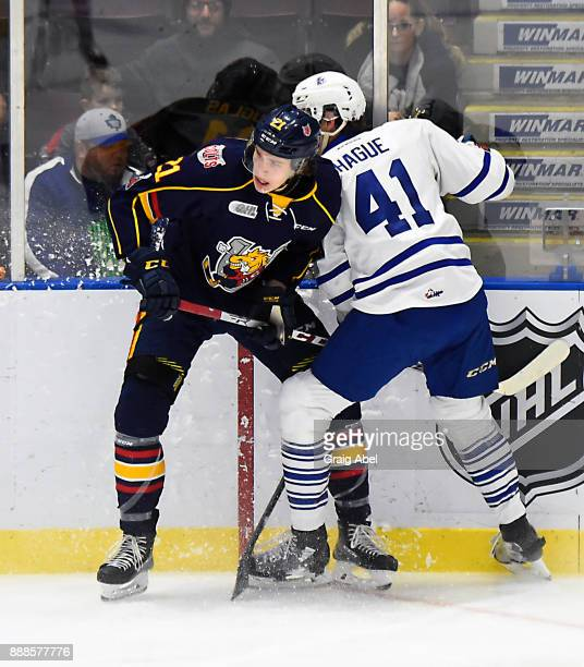 Curtis Douglas of the Barrie Colts battles with Nicolas Hague of the Mississauga Steelheads during OHL game action on December 8 2017 at Hershey...