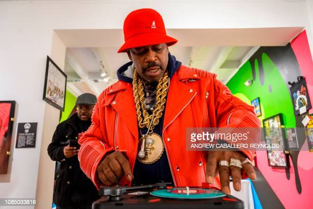 Curtis Fisher aka Grandmaster Caz looks at HipHop memorabilia at the HipHop Museum Pop Up Experience in Washington DC on January 19 2019 The month...