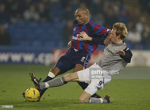 Curtis Fleming of Crystal Palace is tackled by Steve Jones of Crewe Alexandra during the Nationwide Division One match between Crystal Palace and...