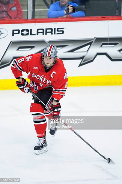 Curtis Gedig of the Ohio State Buckeyes controls the puck during the Big Ten Men's Ice Hockey Championship game against the Wisconsin Badgers on...