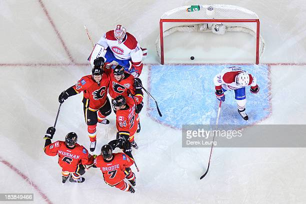 Curtis Glencross of the Calgary Flames celebrates along with his teammates David Jones Jiri Hudler Dennis Wideman and TJ Brodie after scoring a goal...
