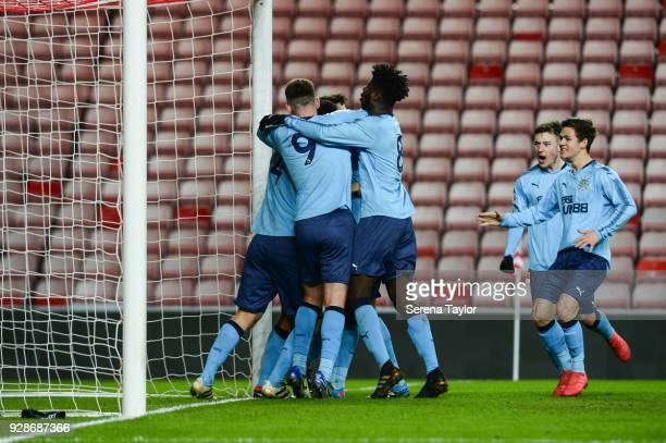 Curtis Good of Newcastle United celebrates with teammates after he scores the opening goal during the Premier League International Cup between...