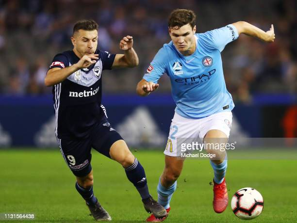Curtis Good of the City keeps possession of the ball from Kosta Barbarouses of the Victory during the Round 20 match between Melbourne Victory and...